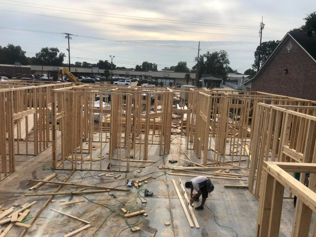 Workers framing a residential property
