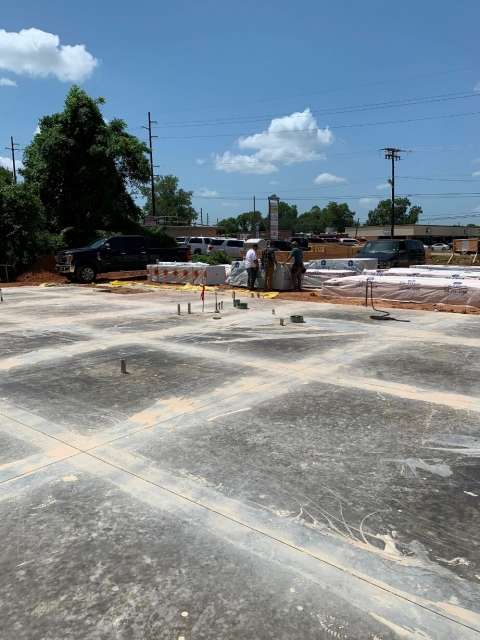Concrete slab being prepped for framing