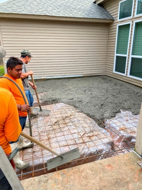 Workers paving cement