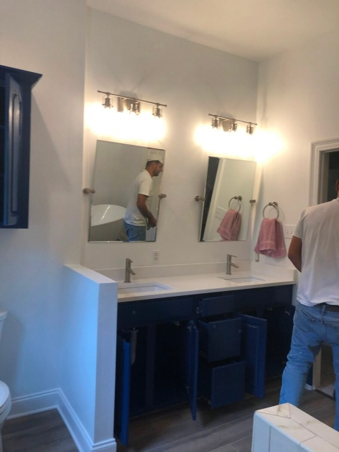 Worker renovating a bathroom vanity