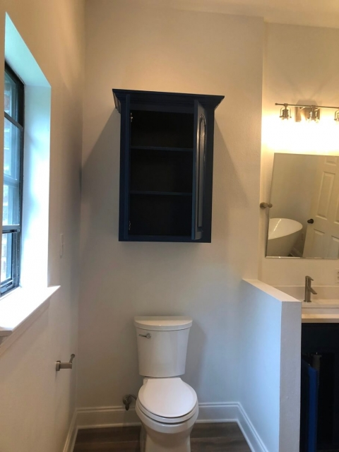 Custom cabinet above toilet